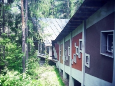 former eni village of borca di cadore_holiday camp building and the woods - photo by alice ferrazza