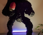 Gino Blanc, Kong plastic evolution, 2012, scultura con missile, polietine, ferro, CA2CO3, legno, bitume, colore ad olio, glitter, vetro, marmo, lingua mozzata, pianta in vaso, 230x120x110 cm., foto Giacomo De Dona